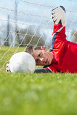 Goalkeeper in red making a save  — Stock Photo