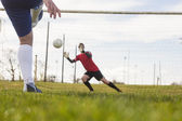 Goalkeeper in red saving a penalty — Foto de Stock