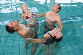 Happy fitness class stretching in aqua aerobics — Stock Photo