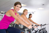 Spin class working out in a row — 图库照片