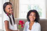 Pretty mother with her daughter offering roses — Stock Photo