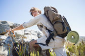 Hiker hiking through rough terrain — Stock Photo