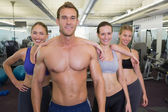 Smiling fitness class posing together — Stock Photo