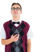 Geeky hipster sending a text — Stock Photo