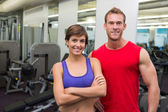 Fit attractive couple smiling at camera — Foto de Stock