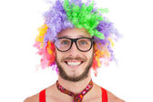Geeky hipster in afro rainbow wig — Стоковое фото