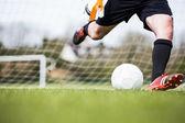 Goalkeeper kicking ball away from goal — Stock Photo
