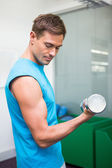 Fit man lifting heavy dumbbell — Stock Photo