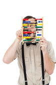 Geeky hipster holding an abacus — Stock fotografie