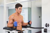 Determined muscular man doing crossfit fitness workout in gym — Stok fotoğraf