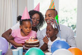 Happy family celebrating a birthday together — Foto Stock