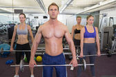 Fitness class lifting barbells together — Stock Photo