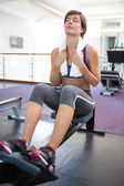 Fit brunette working out on rowing machine — Stock Photo