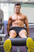 Muscular man doing a leg workout at gym — Stock Photo