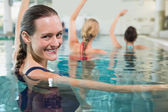 Fitness class doing aqua aerobics — Stock Photo