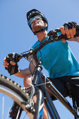 Fit cyclist riding on country trail — Stock Photo