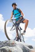 Man cycling on rocky terrain — Stock Photo