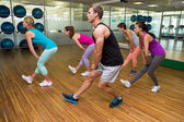 Fitness class led by handsome instructor — Stock Photo
