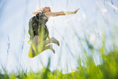 Pretty blonde in sundress jumping up — Stock Photo