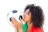 Pretty football fan with portugal flag kissing ball — Stockfoto