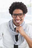 Hipster businessman smiling at camera  — Stockfoto