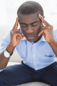 Stressed businessman getting a headache — Stock Photo
