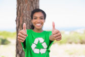 Pretty environmental activist showing thumbs up — Stock Photo