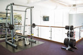 Empty weights room with bench press — Stock Photo