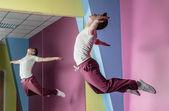 Cool break dancer mid air in front of mirror — Stock Photo