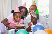 Happy family celebrating a birthday together — Photo
