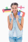 Pretty brunette holding various european flags — Stock Photo