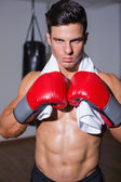 Shirtless muscular boxer in defensive stance — Stock Photo