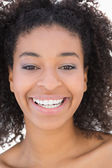Pretty girl with afro hairstyle smiling at camera — Стоковое фото