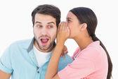 Brunette whispering secret to her boyfriend — Stock Photo