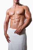 Mid section of a shirtless muscular man in white towel — Stock Photo