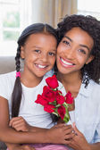 Pretty mother with her daughter holding roses — Stock Photo