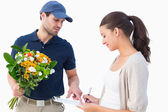 Happy delivery man with customer — Stock Photo