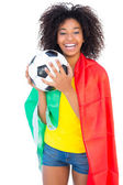 Pretty football fan with portugal flag holding ball — Stock Photo