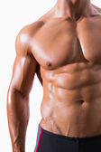 Mid section of shirtless muscular man — Stock Photo