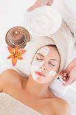 Attractive woman receiving treatment at spa center — Stockfoto