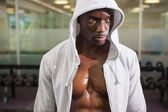 Muscular man in hood jacket — Stock Photo