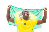 Happy brazilian football fan cheering holding flag — Stock Photo