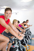 Man smiling at camera during spin class — Stock Photo