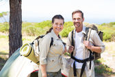 Outdoorsy couple outside their tent — Stock Photo
