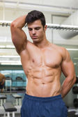 Serious shirtless muscular man in gym — Foto de Stock