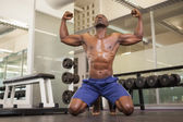 Muscular man flexing muscles in gym — Stock Photo