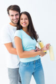 Happy young couple painting together — Stock Photo
