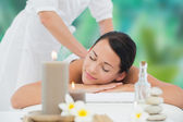 Brunette enjoying back massage — Stock Photo