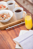 Breakfast on tray on coffee table — Stock Photo