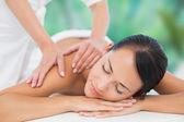 Brunette enjoying back massage — Stock Photo